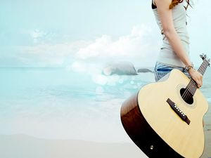 Girl holding guitar seaside ppt background picture