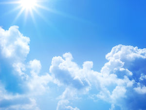 Sunny background with blue sky and white clouds
