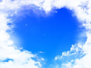 White clouds surrounded by heart-shaped blue sky ppt background picture